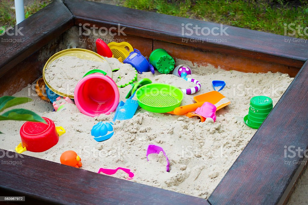 Nursery sandbox with sand equipment stock photo