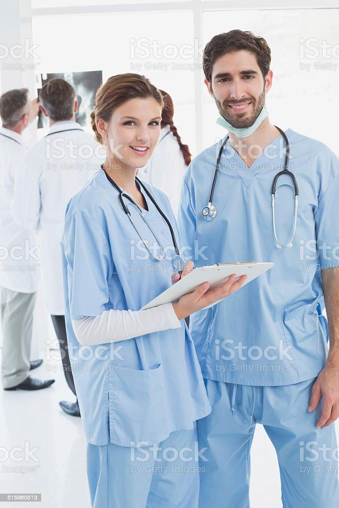 Nurses holding a file together stock photo