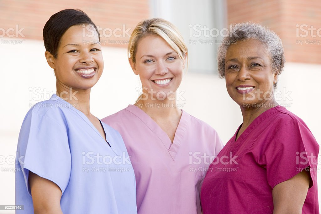 Nurses Standing Outside A Hospital stock photo