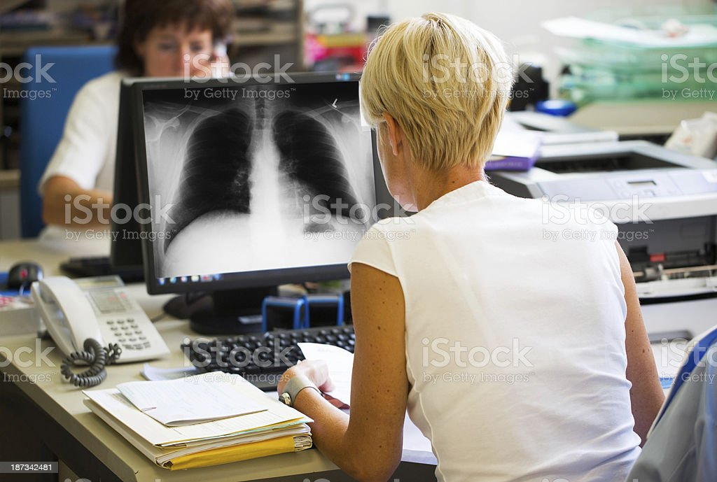 Nurses working with computer...one is watching x-ray image royalty-free stock photo
