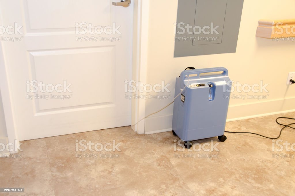 Nursing home hall with oxygen producing machine stock photo
