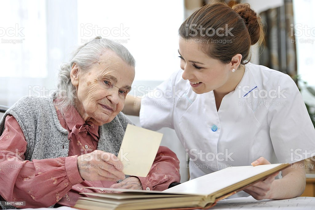 Nursing home with nurse and old lady royalty-free stock photo