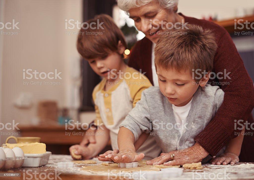 Nurturing budding little bakers stock photo