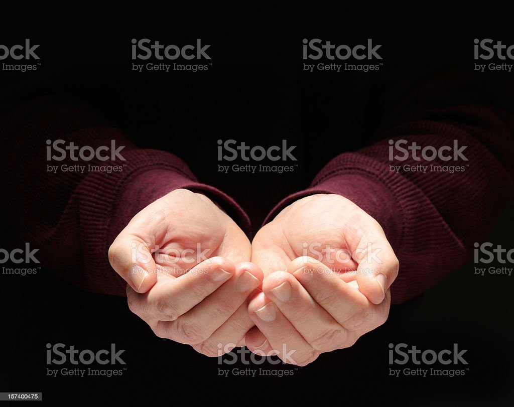 Nurturing Hands Cupped, Empty, Clasped to Hold Something, Black Background stock photo