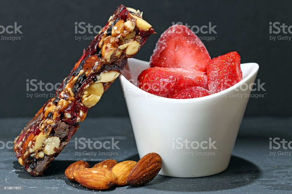 Nut bar with almonds and strawberry stock photo
