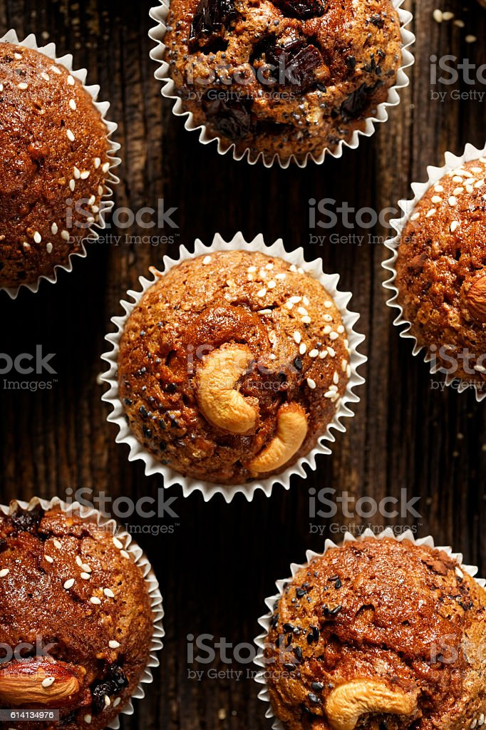 Nut chocolate muffins homemade on rustic wooden table stock photo