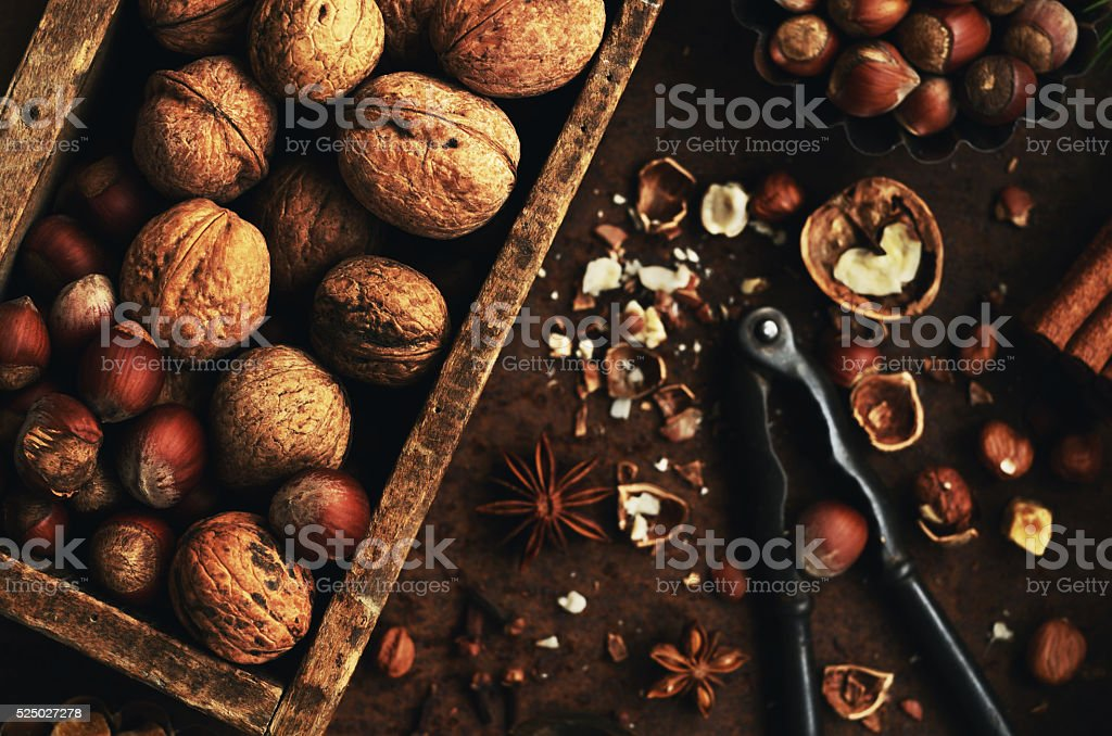 Nut mix - hazelnut and walnut in rustic wooden crate stock photo