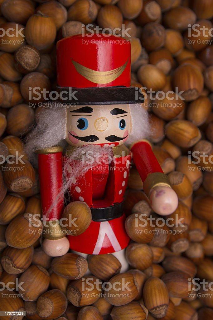 Nutcracker among nuts stock photo
