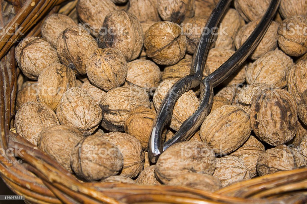 nutcracker and walnuts in the basket stock photo
