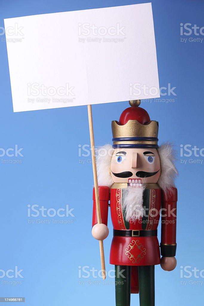 Nutcracker Holding Blank Card stock photo