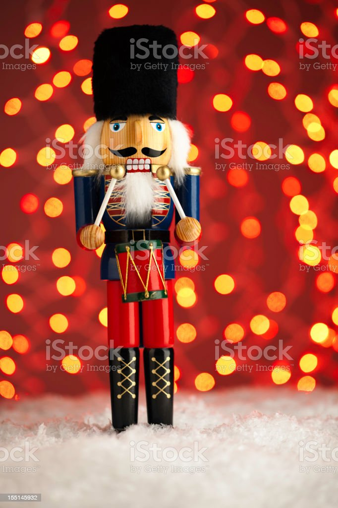 Nutcracker in Snow with Lights stock photo