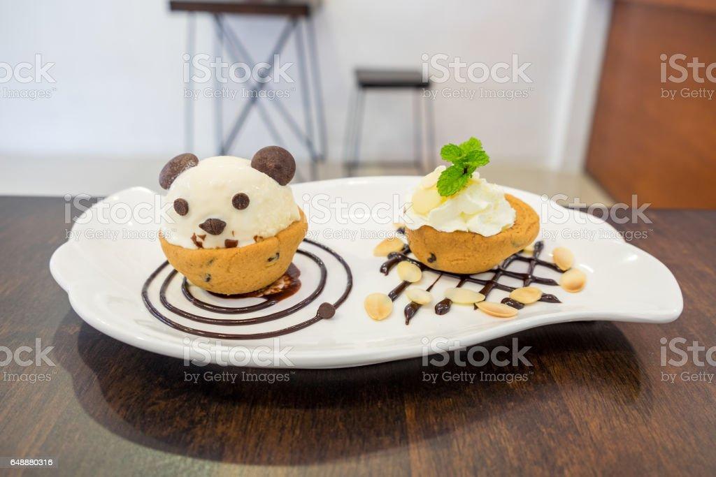 Nutella cookie cup ice cream panda on chocolate stock photo