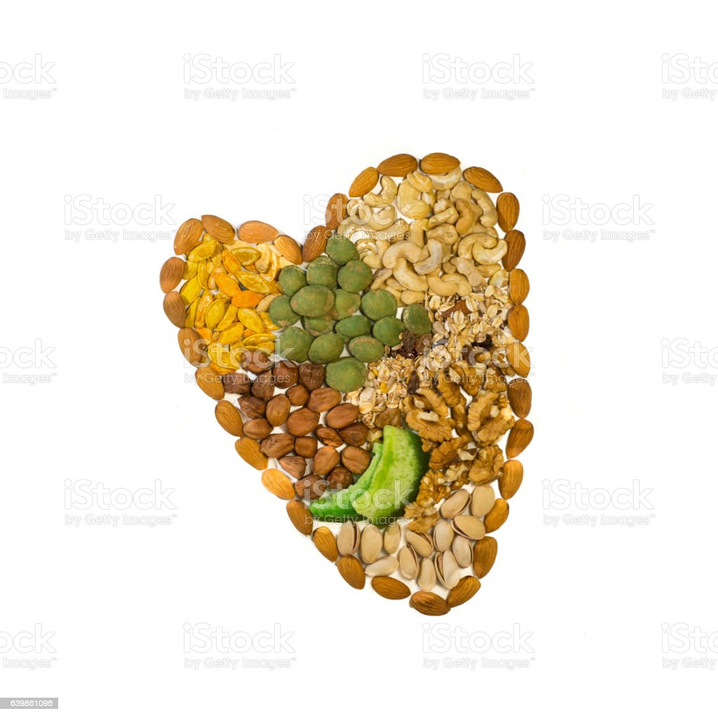 Nutes and grains in heart shape stock photo