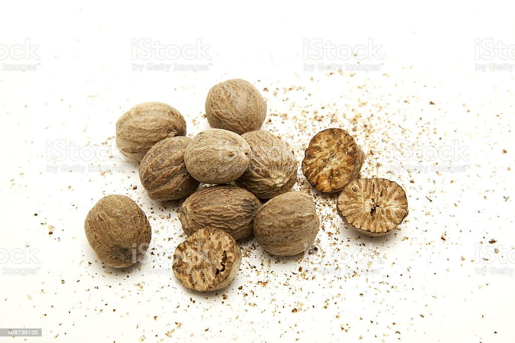 Nutmeg and its powder on white background stock photo