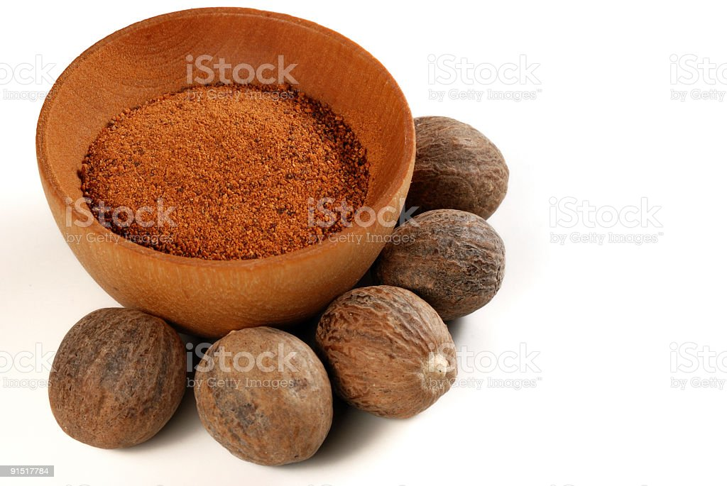 Nutmeg nut and powder royalty-free stock photo