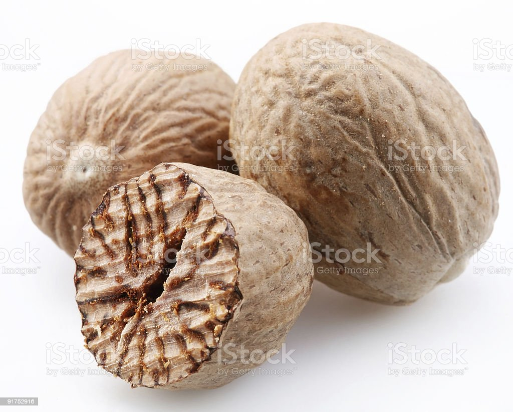 Nutmeg on a white background stock photo
