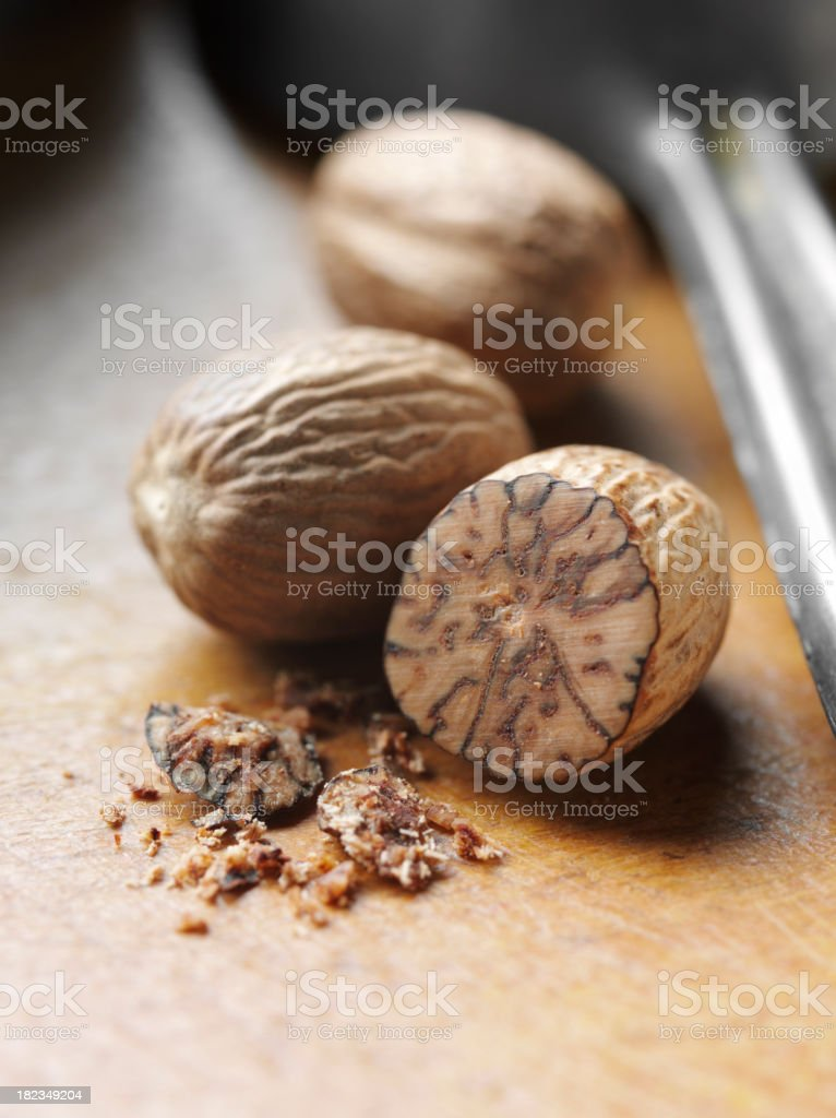 Nutmeg on a Wooden Board stock photo