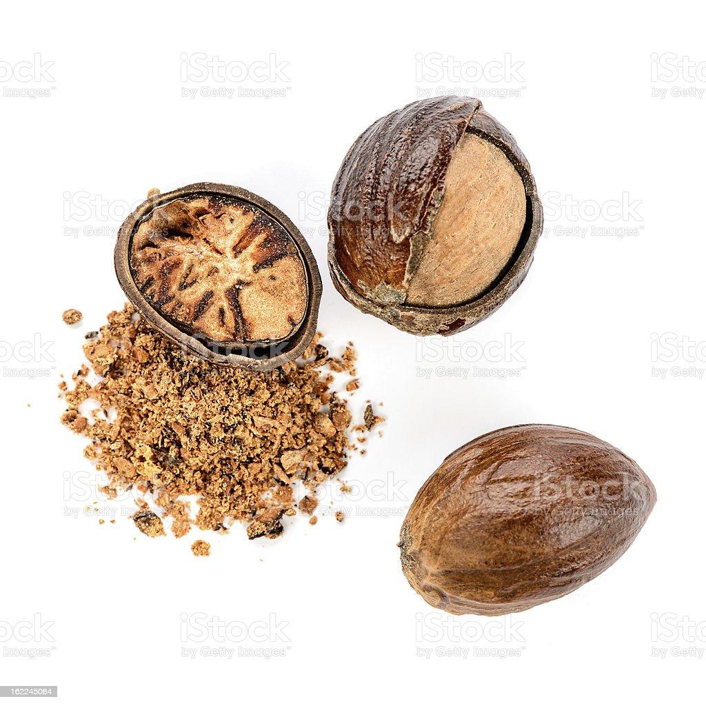 Nutmeg - whole and powdered royalty-free stock photo