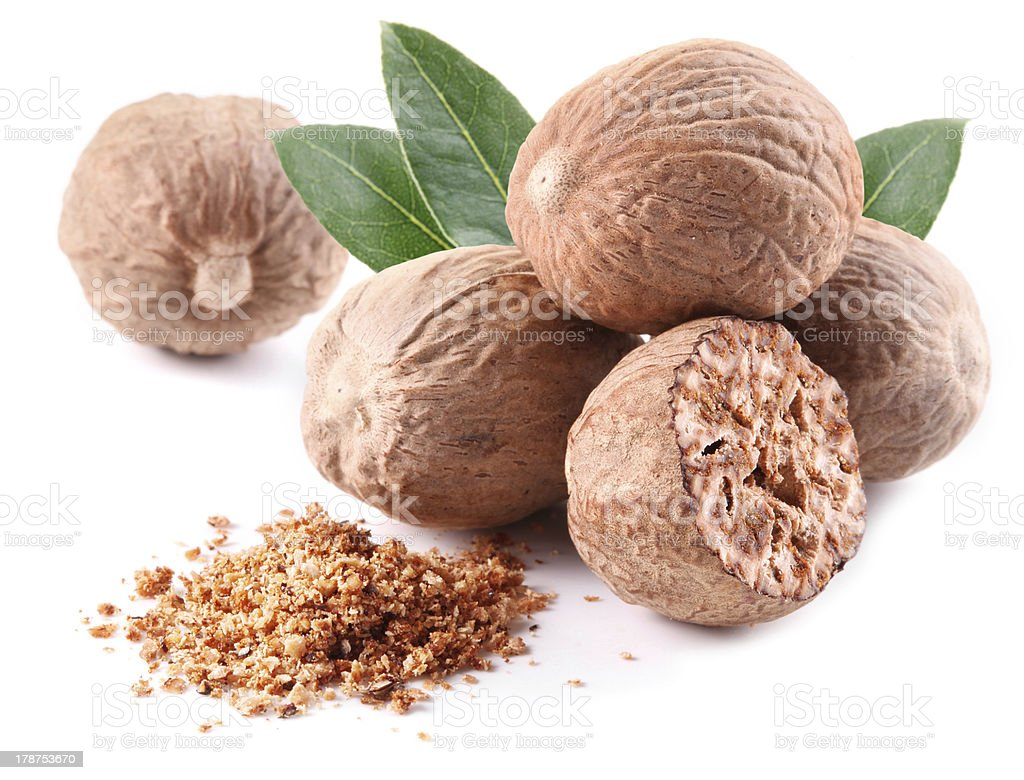 Nutmeg with leaves. stock photo