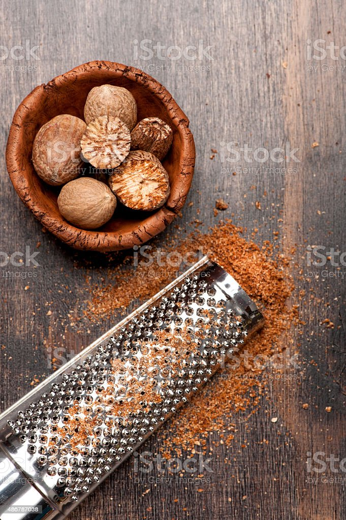Nutmegs grated stock photo
