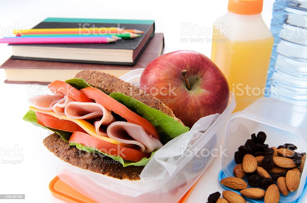 Nutritious back to school lunch arranged on a table stock photo