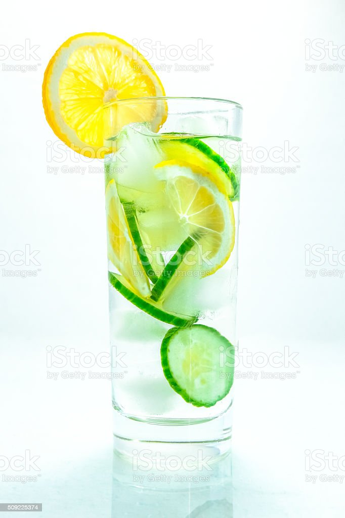 Nutritious detox water with lemon and cucumber in a glass stock photo