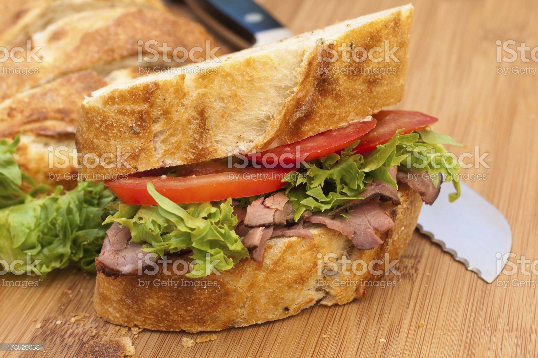 Nutritious lunch sandwich. Homemade artisanal black peppercorn bread. royalty-free stock photo