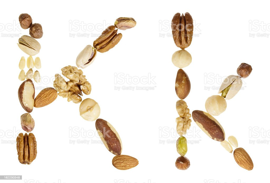 Nuts alphabet letter K, upper and lower case royalty-free stock photo