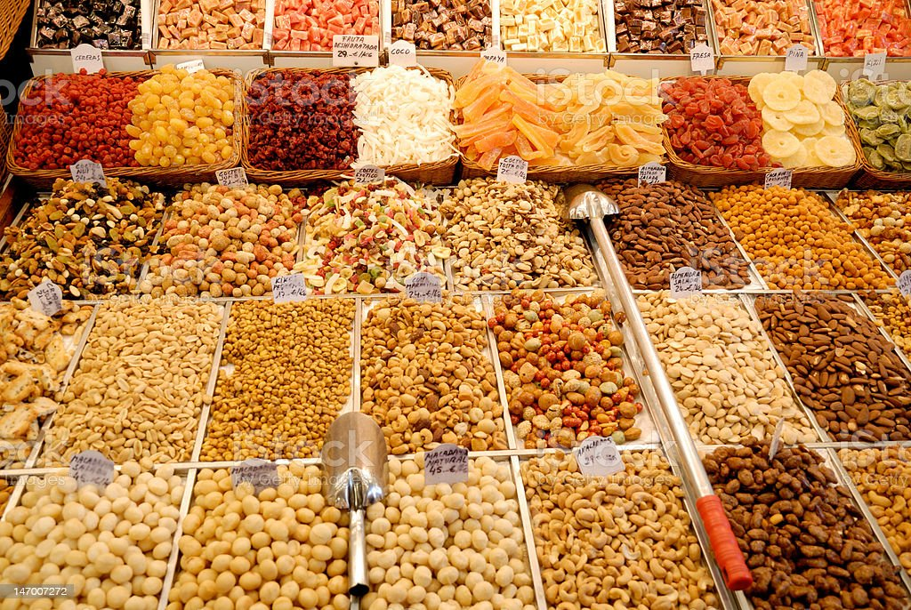 Nuts and candies at market in Barcelona royalty-free stock photo