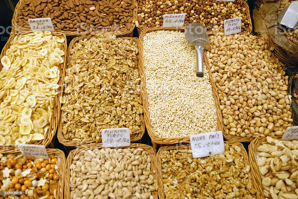Nuts and dried fruits at market in Barcelona royalty-free stock photo