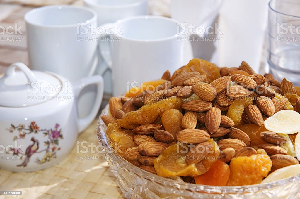 Nuts and dried fruits with a tea set royalty-free stock photo