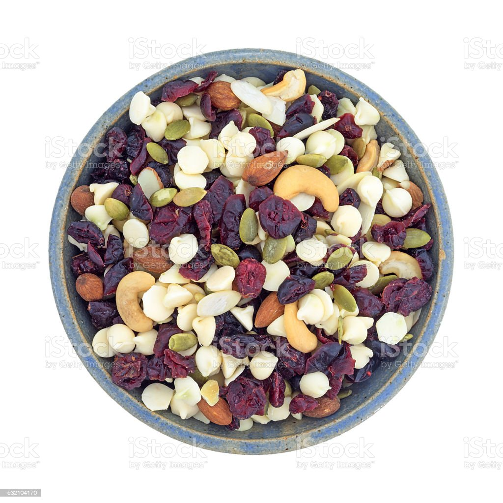 Nuts and fruit trail mix in a bowl top view stock photo