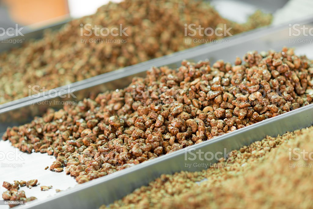 nuts and roasted almonds for selling on market stock photo