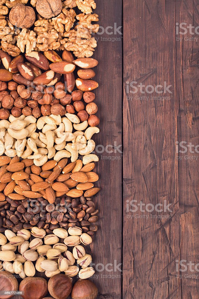 Nuts background at left side stock photo
