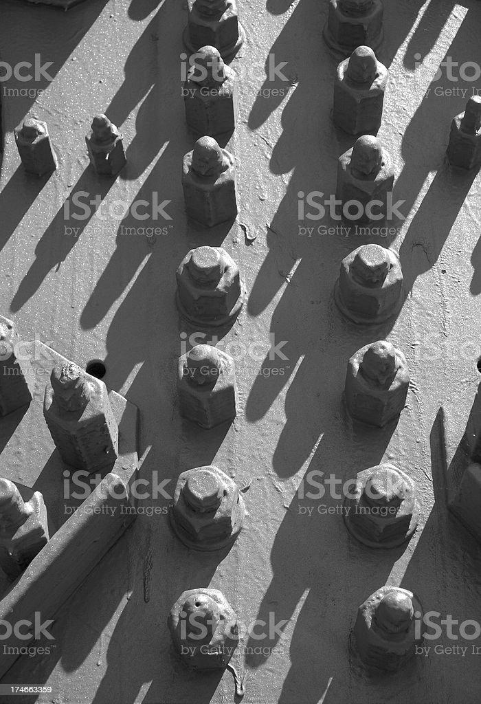 Nuts bolts row teamwork royalty-free stock photo