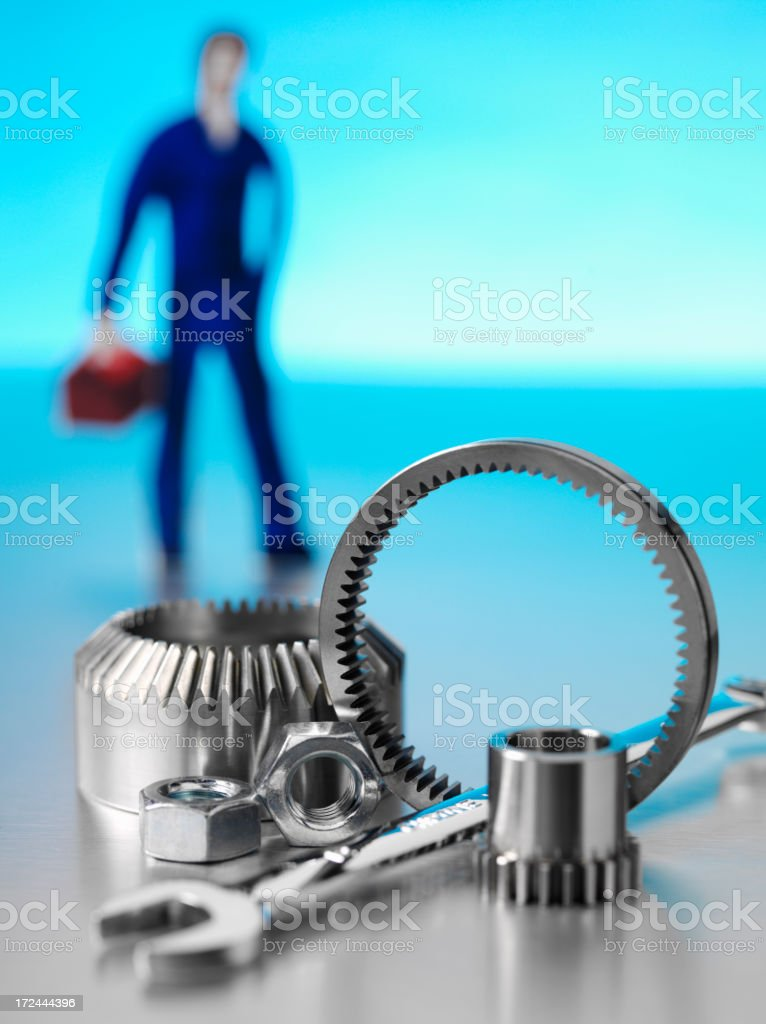 Nuts, Bolts, Wheels and Cogs with a Car Mechanic royalty-free stock photo