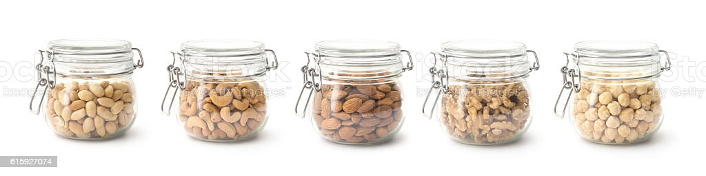 Nuts in the glass jar stock photo