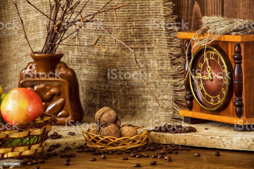 Nuts on burlap background and watches stock photo