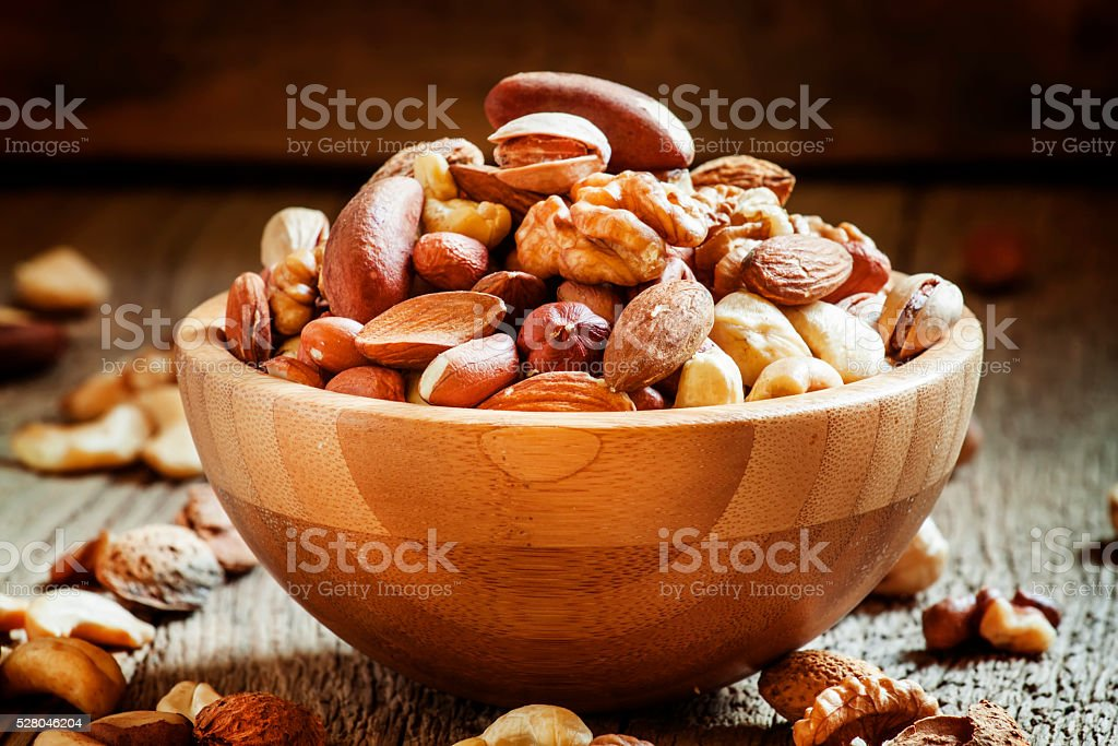 Nuts set in bowl almonds, pistachios, cashews, hazelnuts stock photo
