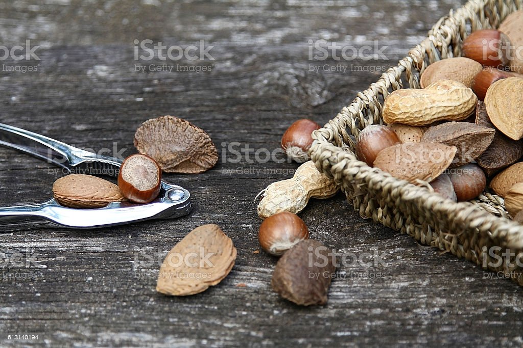 Nuts with nut-cracker stock photo
