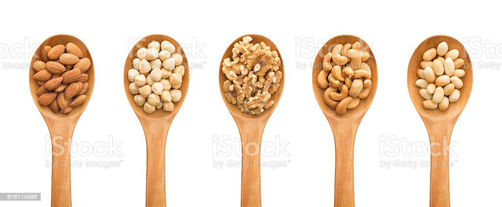 Nuts with wooden spoons stock photo