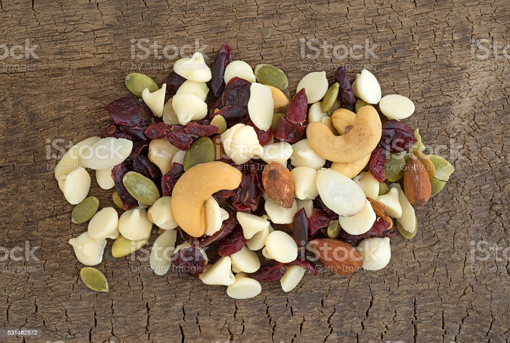 Nutty nuts and fruit trail mix on a board stock photo
