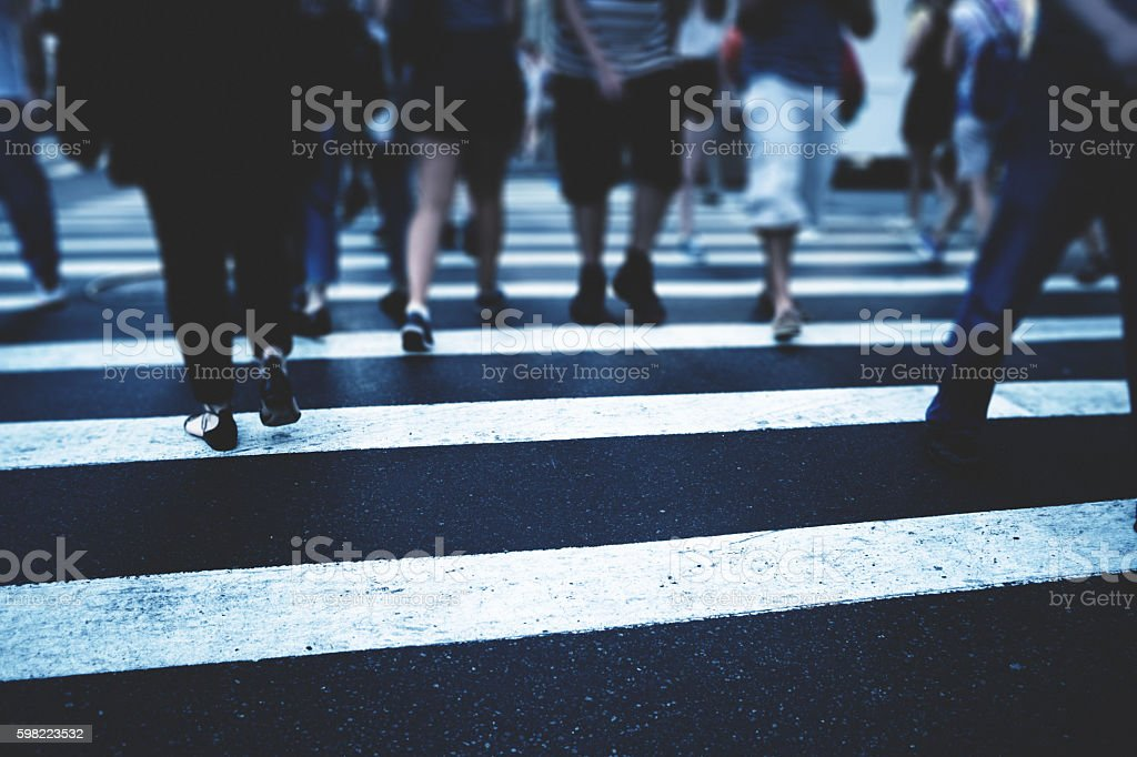 nyc commuters crossing the street stock photo