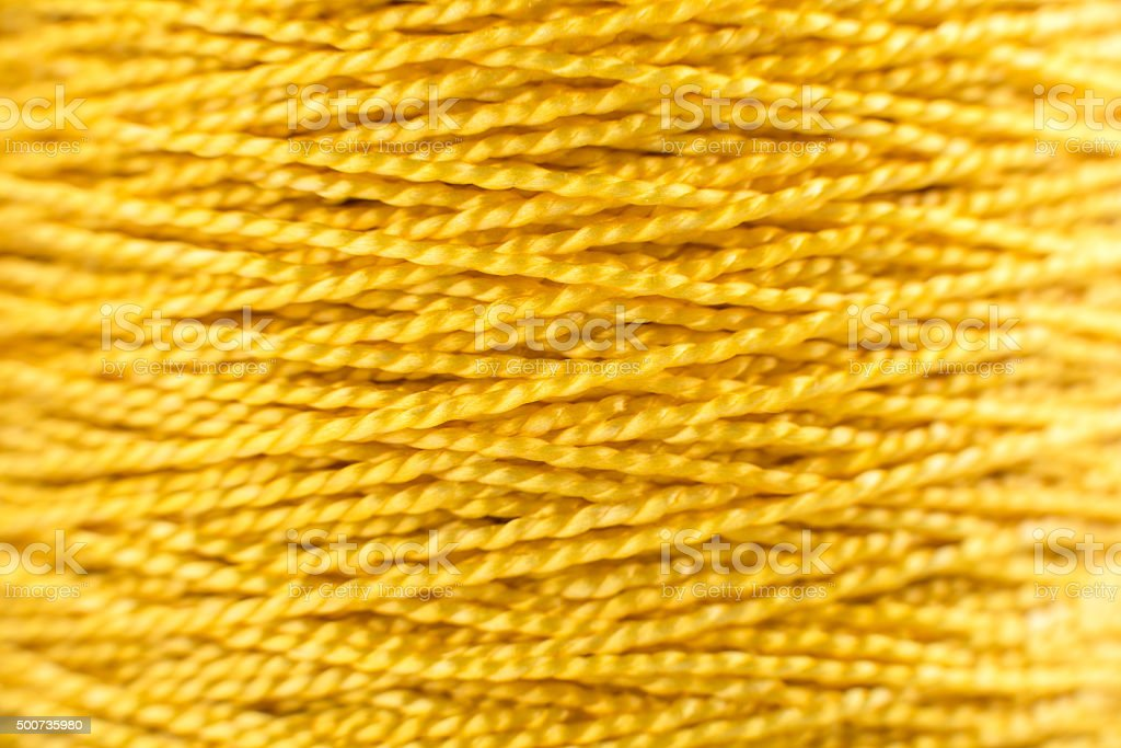 Nylon thread yellow macro stock photo
