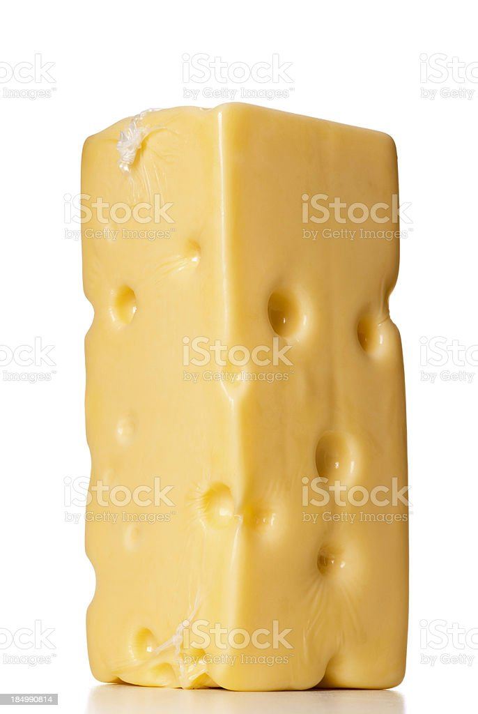 nylon wrapped swiss cheese block stock photo