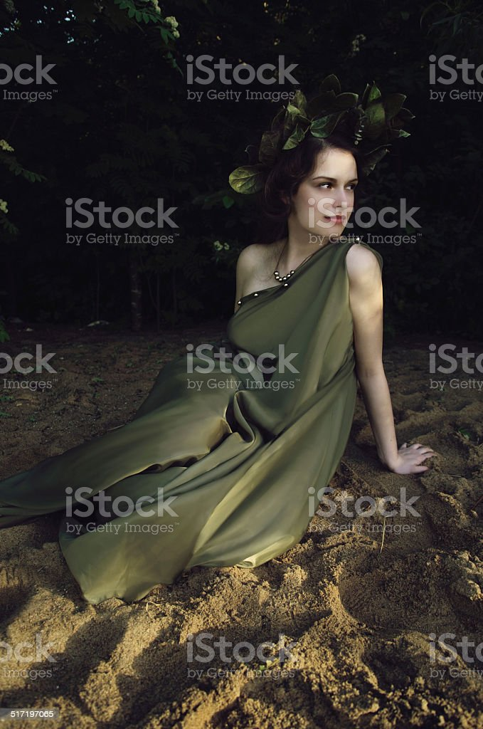 nymph in the woods stock photo