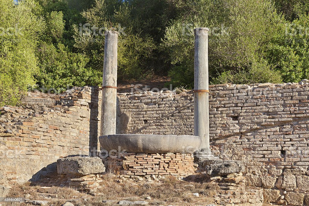 Nympheum water fountain to Herdoes Atticus in Olympia Greece stock photo