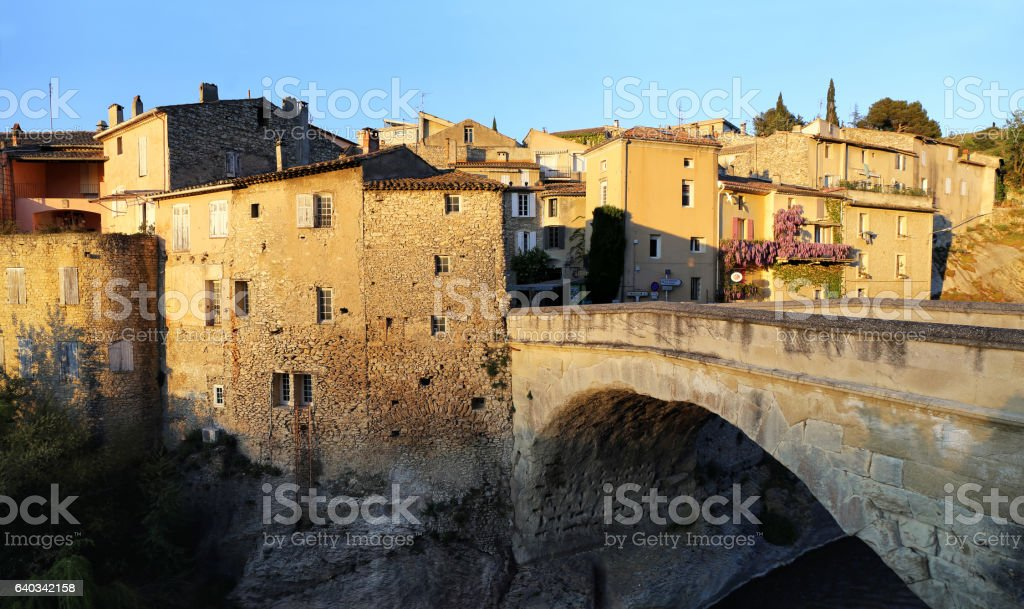 Nyons village,  Medieval bridge at sunset stock photo