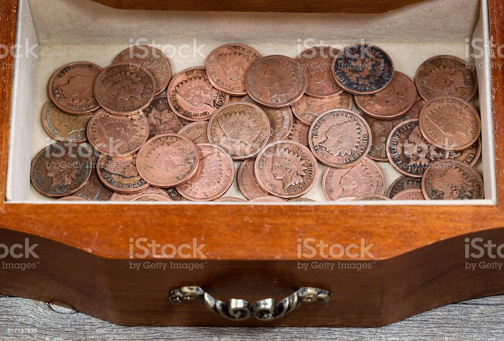 Oak antique dresser drawer filled with old Indian Head Cents stock photo