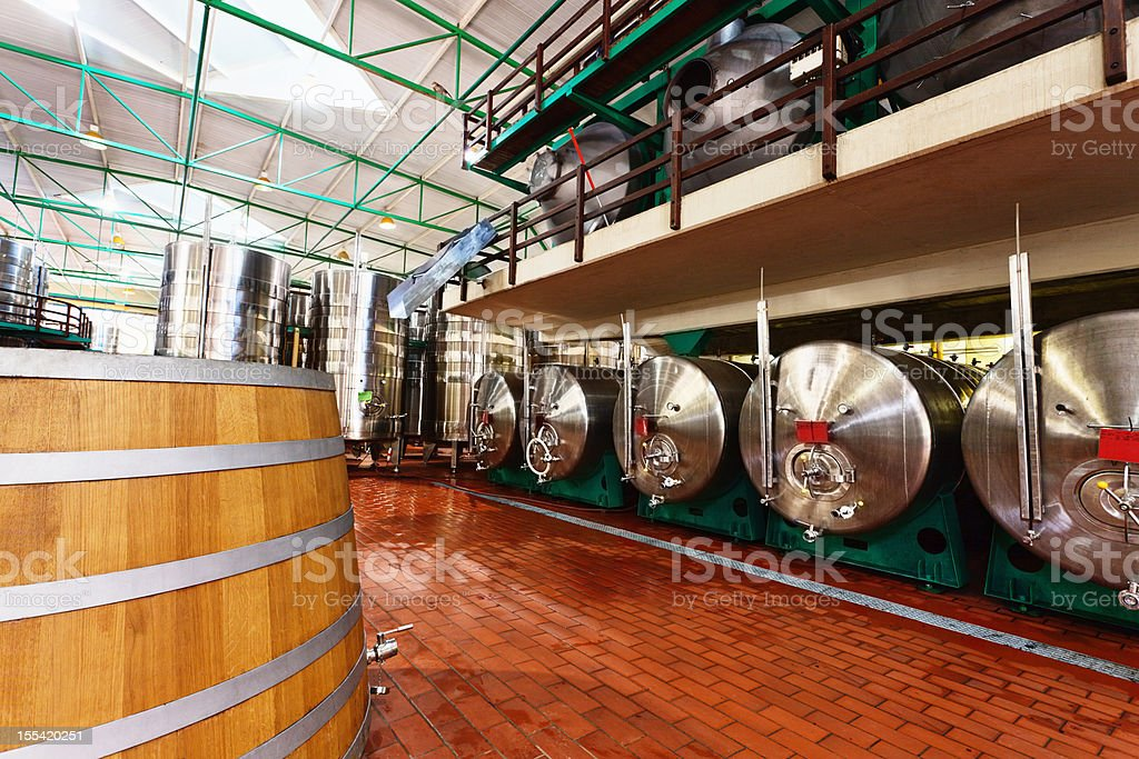 Oak barrels and stainless steel: winery mixes old with new royalty-free stock photo